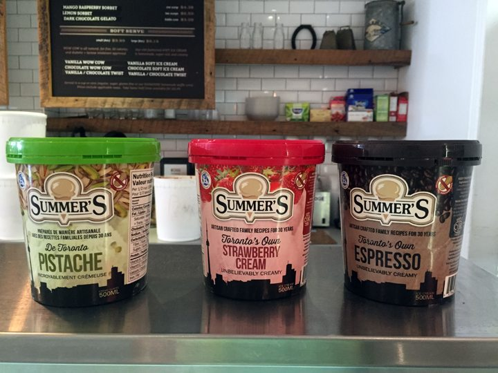 Photo of three tubs of Ice Cream on a Counter: Pistachio, Strawberry Cream, and Espresso