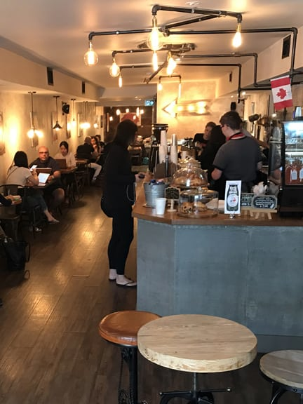 The counter and seating of a coffee shop