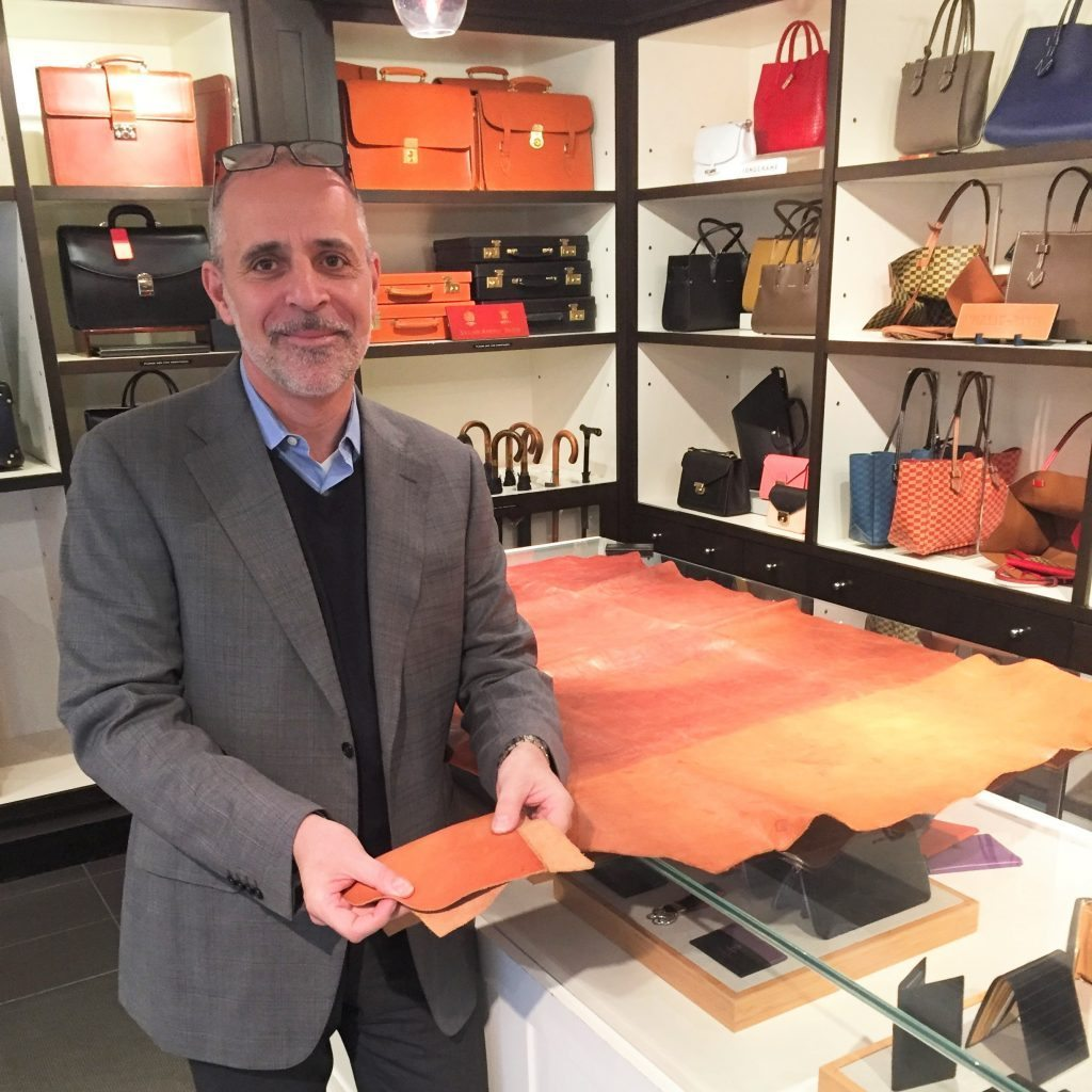 Photo of Michael Warwick holding a Leather Sample at Betty Hemmings Yorkville