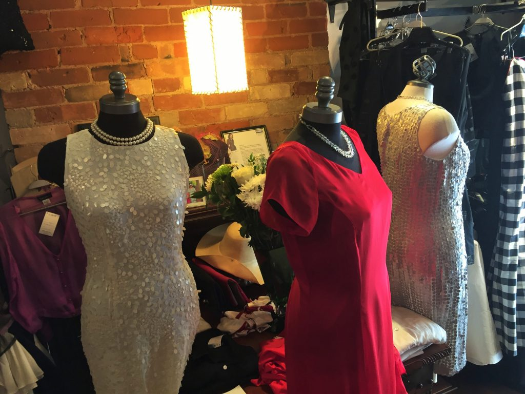 Photo of Dresses on display at the front of the store