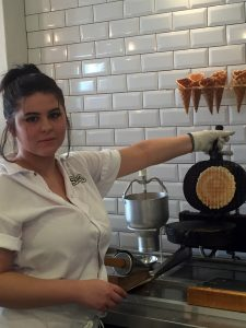 Photo of an employee at Summer's making a fresh waffle cone